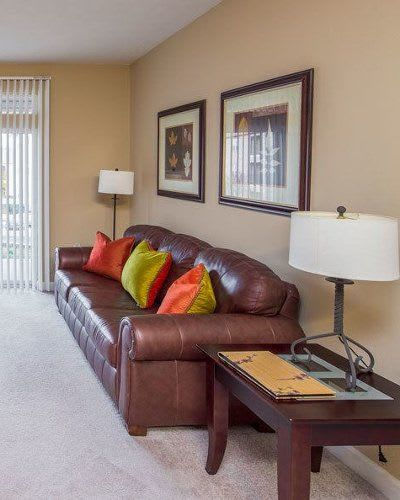 Cozy couch at Main Street Apartments home in Huntsville, Alabama}