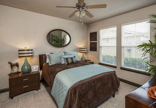 Well decorated bedroom at Millennium Towne Center home in Baton Rouge