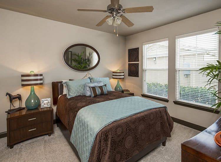Well decorated bedroom at Millennium Towne Center in Baton Rouge