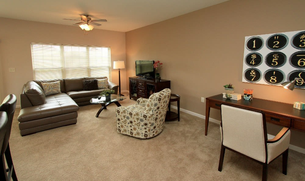 Spacious living room at Preserve at Autumn Ridge home in Watertown, NY