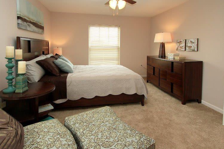 Beautifully designed bedroom at Preserve at Autumn Ridge in Watertown, New York
