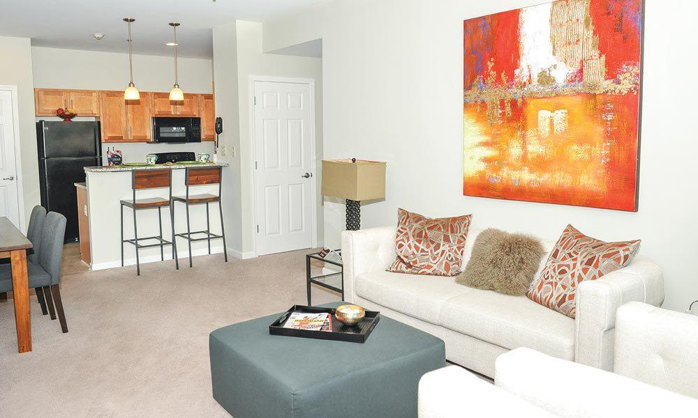 Beautifully designed living room at Rivers Pointe Apartments home in Liverpool, NY