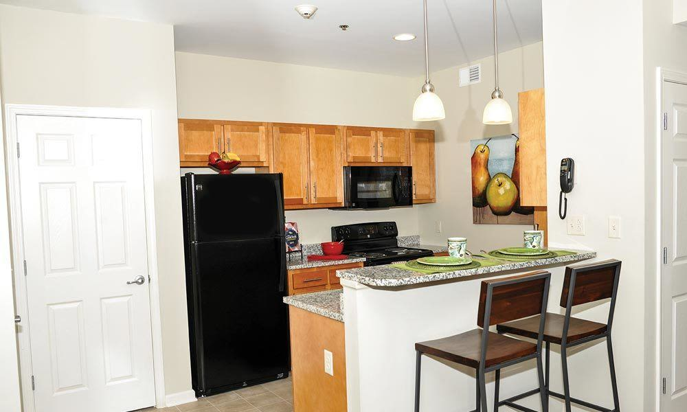 Fully-equipped kitchen at Rivers Pointe Apartments home in Liverpool, NY