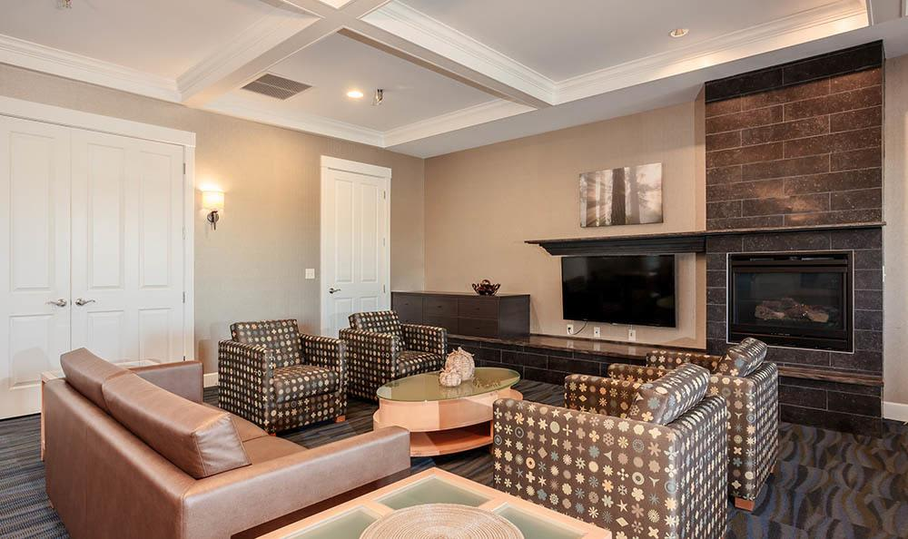Clubhouse seating and fireplace at Rivers Pointe Apartments in Liverpool, NY