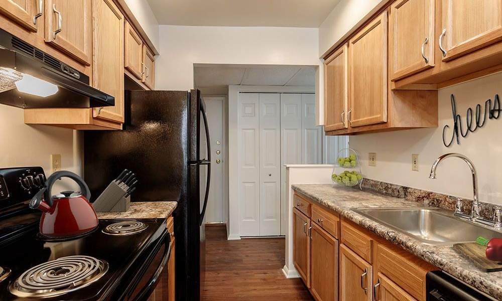 Fully-equipped kitchen at Steeplechase Apartments in Camillus