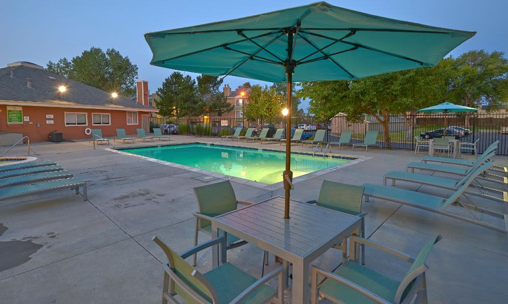 A swimming pool that is great for entertaining at Alton Green Apartments in Denver, CO