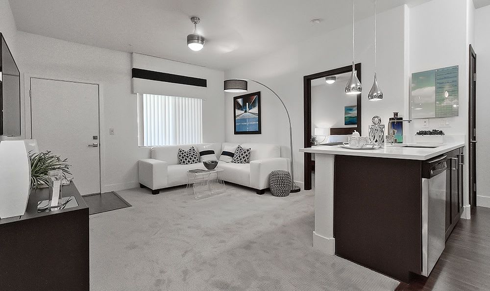 Another model home showcasing plush carpet and contemporary decor at Dream Apartments in Henderson
