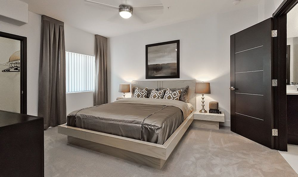 Spacious bedroom with luxurious furnishings at Dream Apartments in Henderson