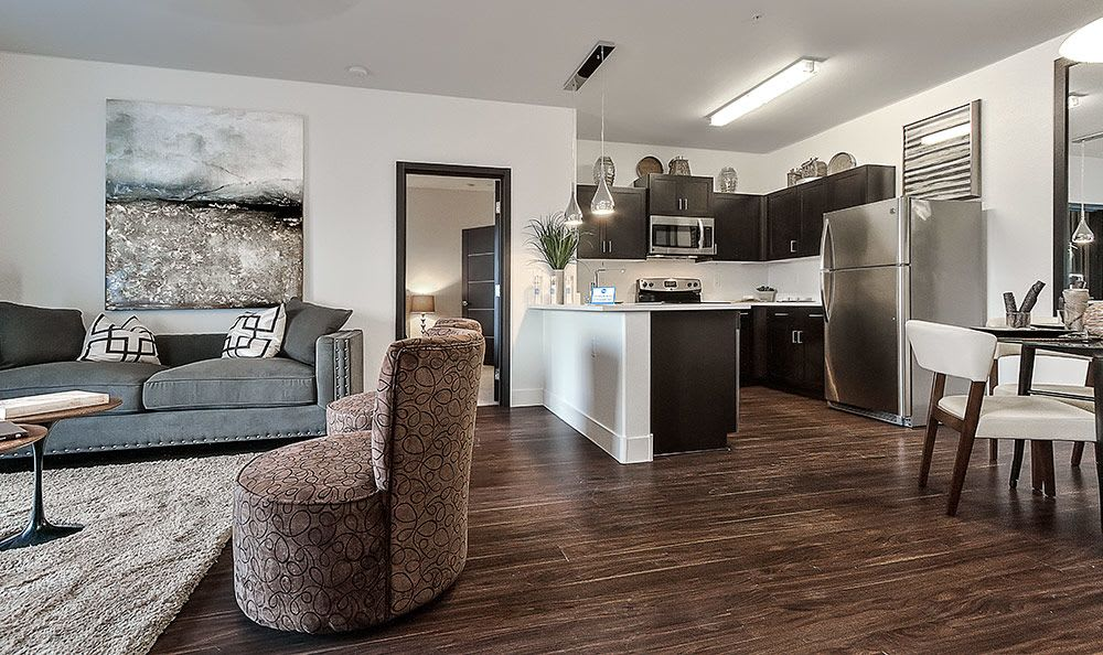Hardwood floors and beautiful decor in model apartment home at Dream Apartments in Henderson