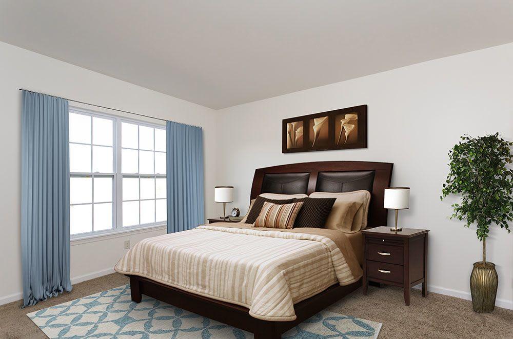Spacious bedroom at Avon Commons in Avon, New York