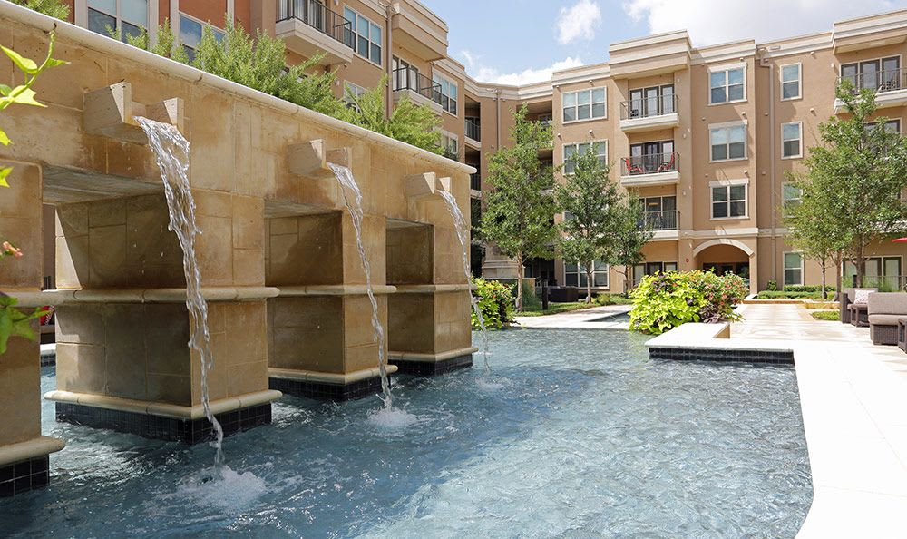 Fountains and pools abound in the common areas at Addison Keller Springs in Addison