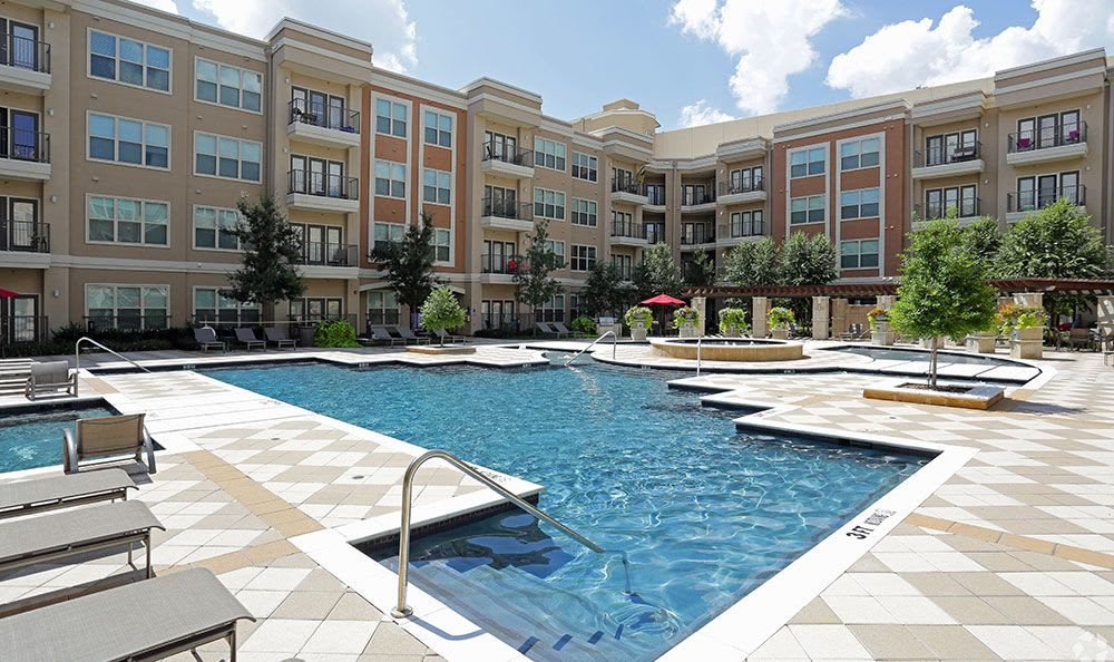 Gorgeous swimming pool area at Addison Keller Springs in Addison
