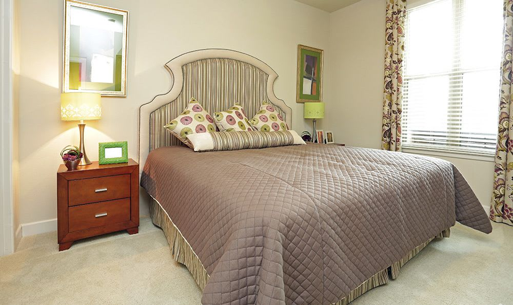 Lovely bedroom decor in model home at Addison Keller Springs in Addison