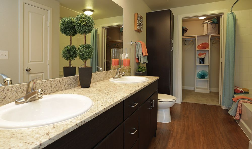 Large dual-sink bathroom in model apartment home at Addison Keller Springs in Addison