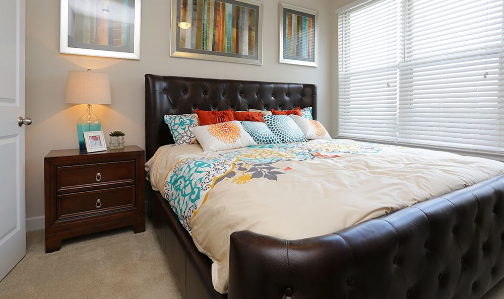 Bold furniture in model bedroom at Addison Keller Springs in Addison