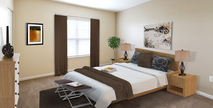 Well decorated bedroom at Ethan Pointe Apartments home in Rochester