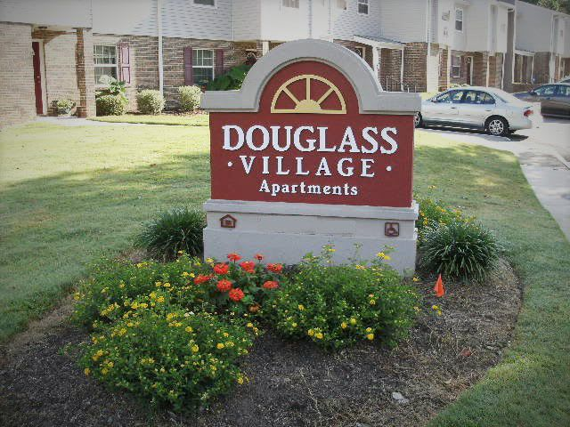 Douglass Village Apartments welcome sign