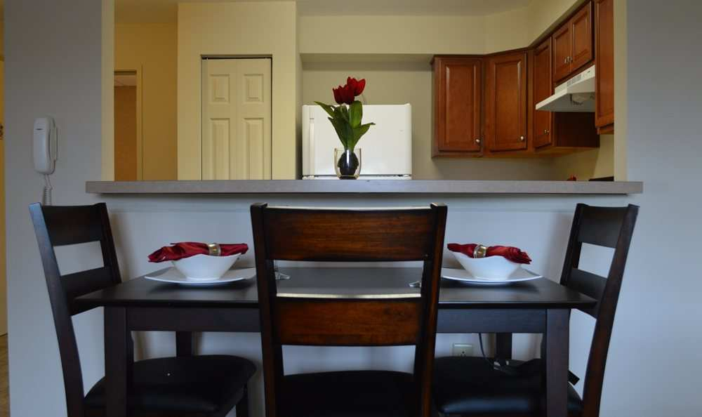Dining table at Greenwood Cove Apartments home in Rochester