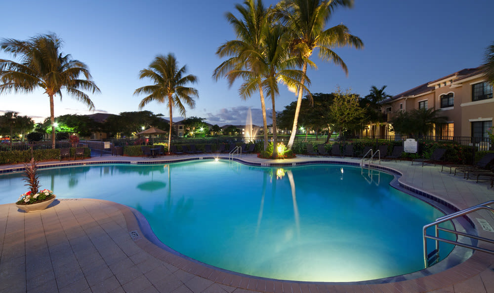 Swimming pool at dusk at San Merano at Mirasol in Palm Beach Gardens