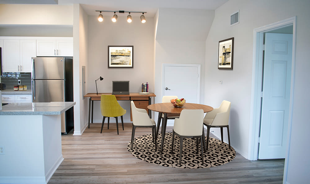 Dining area and office nook in model home at San Merano at Mirasol in Palm Beach Gardens