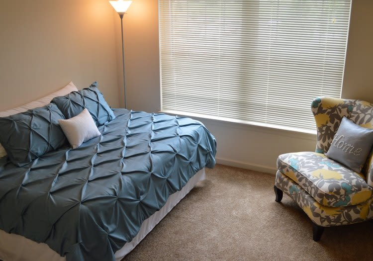Well decorated bedroom at Greenwood Cove Apartments