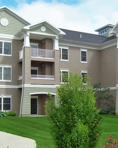 Exterior view of apartment buildings at Greenwood Cove Apartments in Rochester, NY