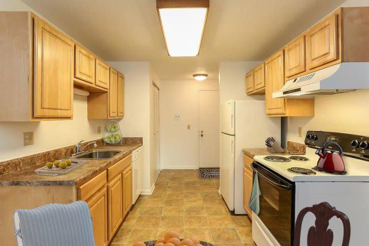 Well-equipped kitchen at Henrietta Highlands in Henrietta, New York