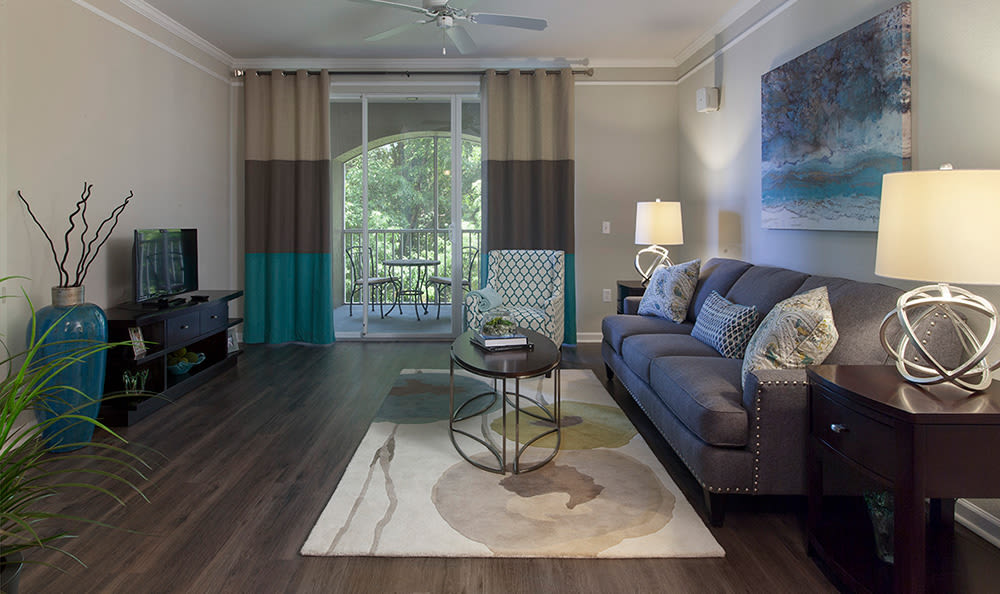 Spacious living room with contemporary decor in model apartment home at The Estates at Park Avenue in Orlando