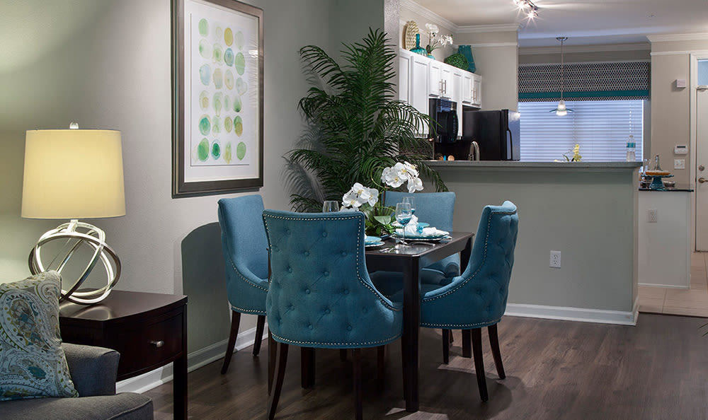 Dining area adjacent to kitchen in model home at The Estates at Park Avenue in Orlando