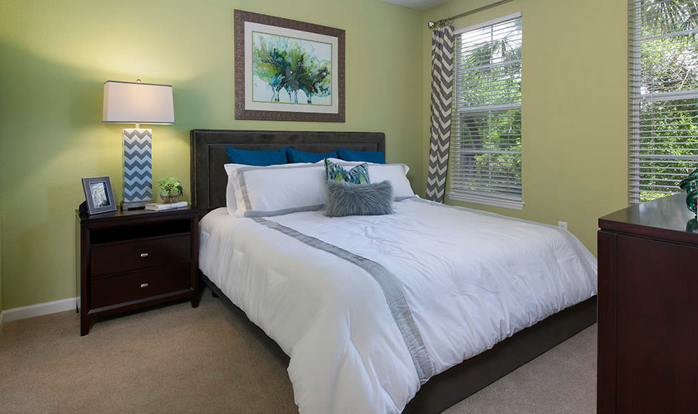 Bright and spacious bedroom in model home at The Estates at Park Avenue in Orlando