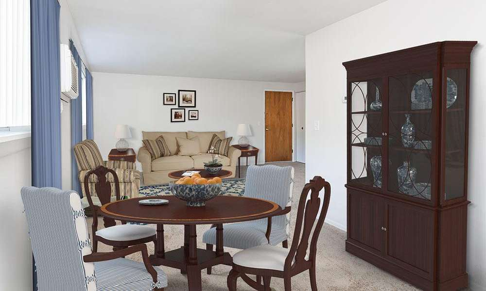 DIning room and living room view at Long Pond Gardens Senior Apartments in Rochester