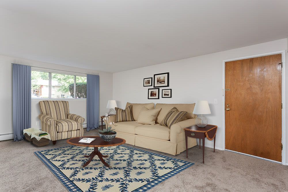 Living room at Long Pond Gardens Senior Apartments in Rochester, New York