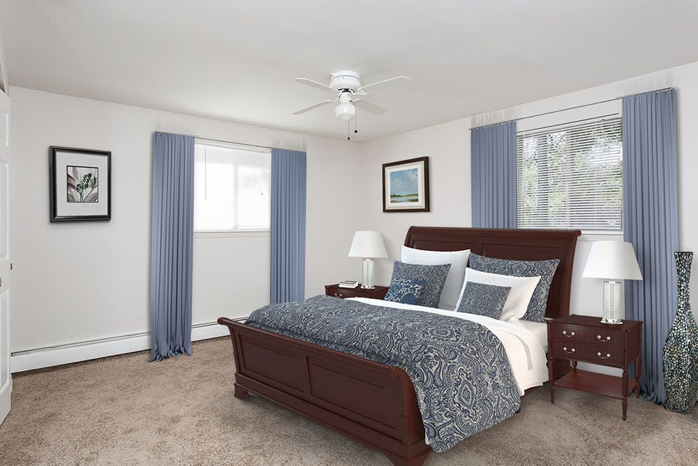 Well decorated bedroom at Long Pond Gardens Senior Apartments in Rochester, New York