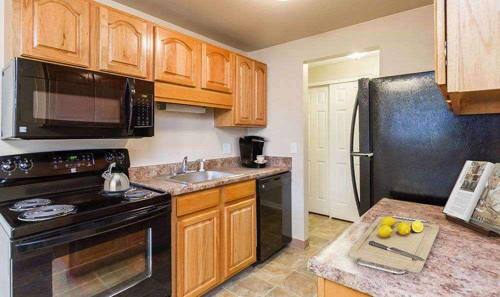 Well-equipped kitchen at Newcastle Apartments in Rochester