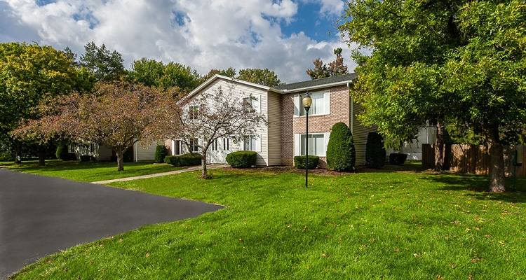 Exterior view of apartment buildings at Newcastle Apartments community situated in Rochester, New York
