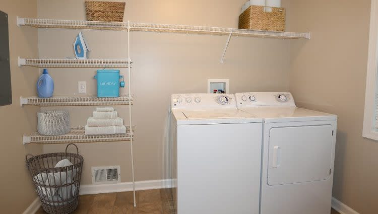 Washer and dryer at North Ponds Apartments home