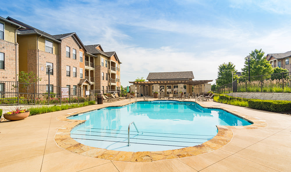 Beautiful swimming pool area at West End at City Center in Lenexa, KS