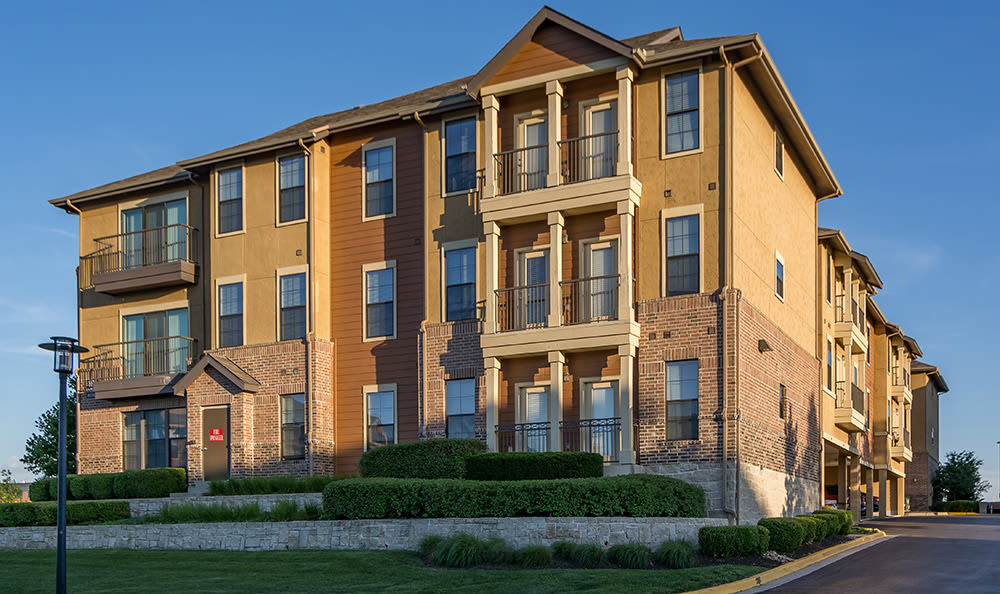 Exterior view of resident building in the evening at West End at City Center in Lenexa