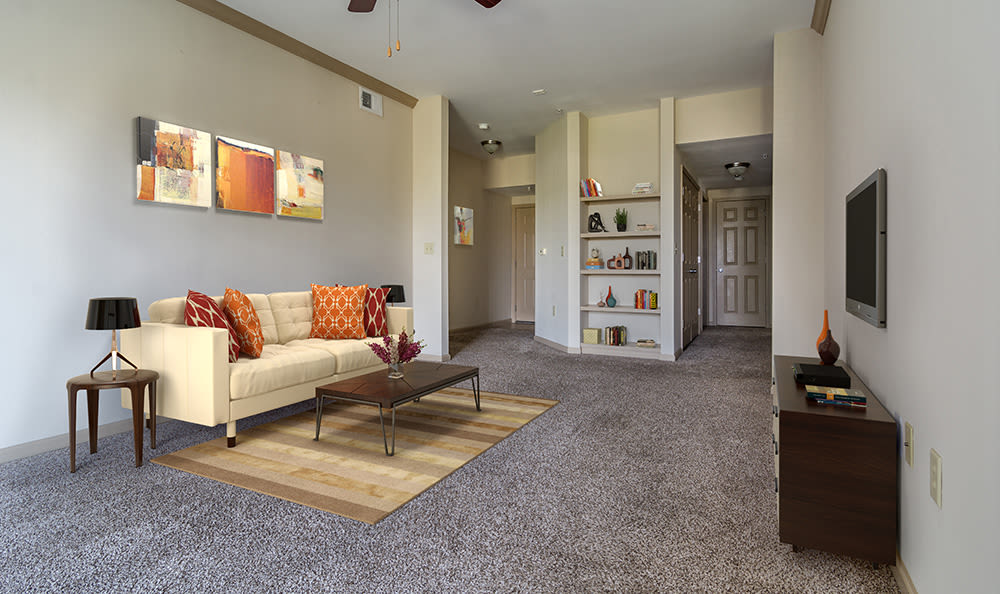 Wide angle view of living room and open floor plan layout at West End at City Center in Lenexa