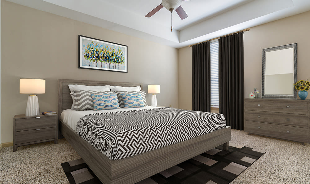 Another model bedroom, showcasing large windows and plush carpeting in model home at West End at City Center in Lenexa