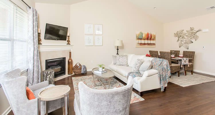 Luxury living room at Orchard View Senior Apartments home in Rochester