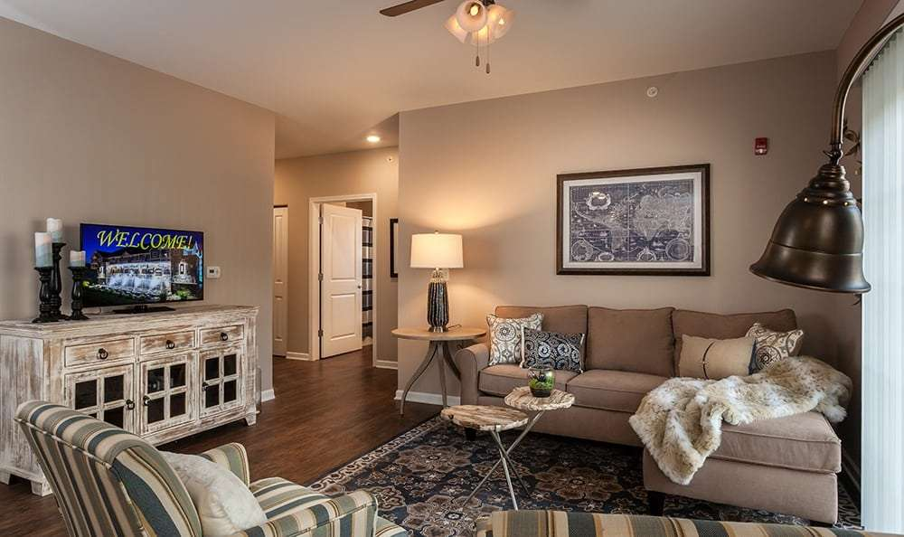 Spacious living room at Waters Edge Apartments in Webster