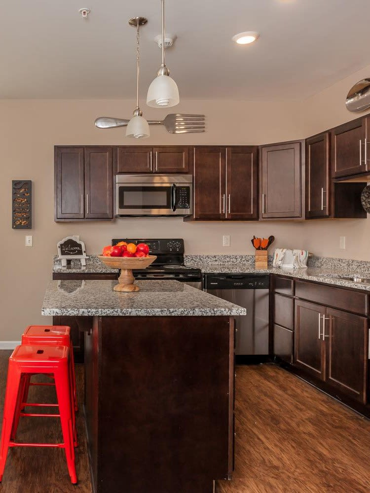 Well-equipped kitchen at Waters Edge Apartments home
