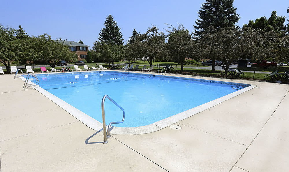 Sparkling pool at Waverlywood Apartments and Townhomes in Webster, NY