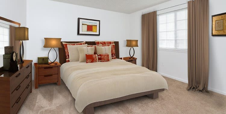 Cozy bedroom at Waverlywood Apartments and Townhomes in Webster