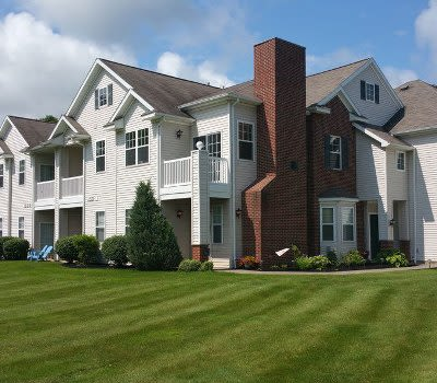 Front exterior view of apartments at Webster Green in Webster