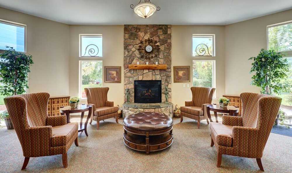 Lounge with fire place at Middlefield Oaks