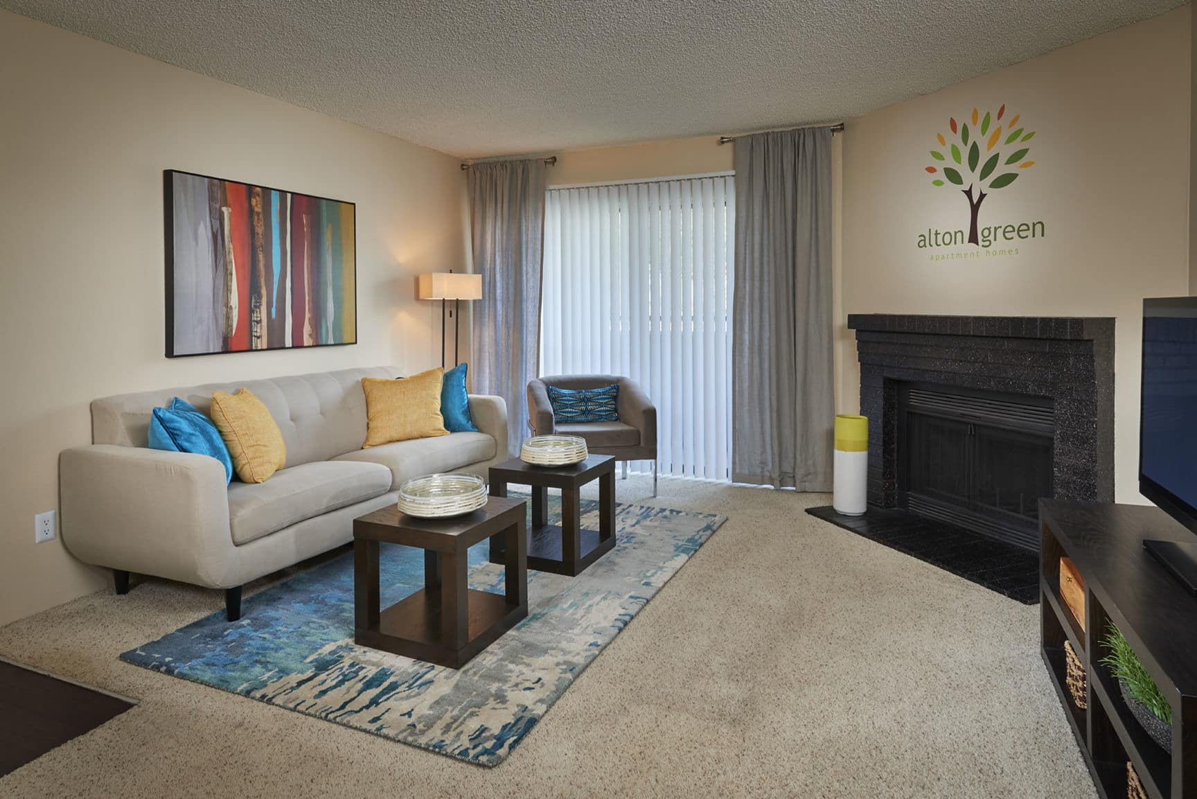 Well Decorated Living Room at Alton Green Apartments in Denver, CO