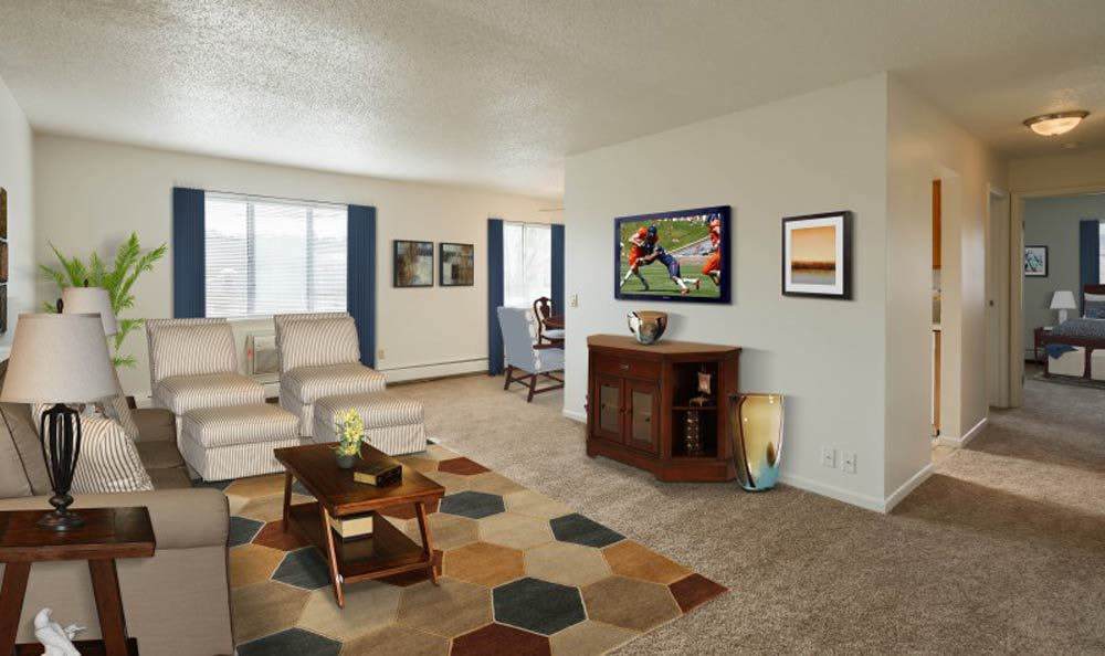 Beautifully designed living room for your comfort at Knollwood Manor Apartments in Fairport, NY