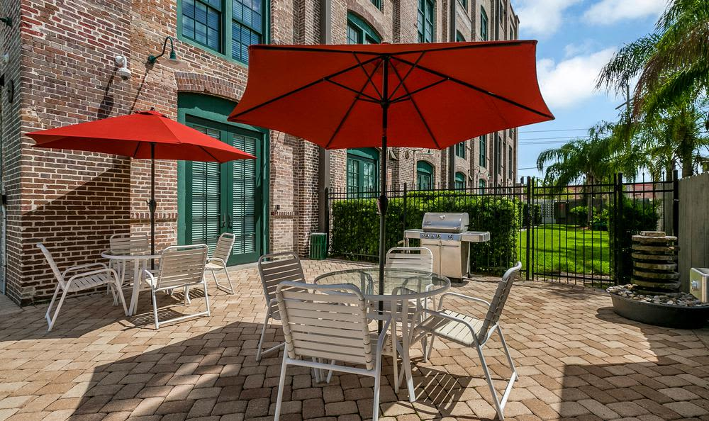 Chairs with Umbrellas at Josephine Lofts in New Orleans, LA.
